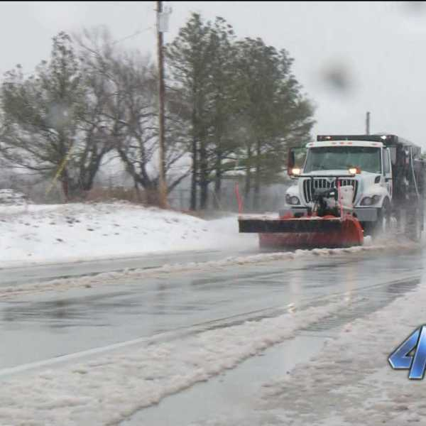 Road crews truck salt plow