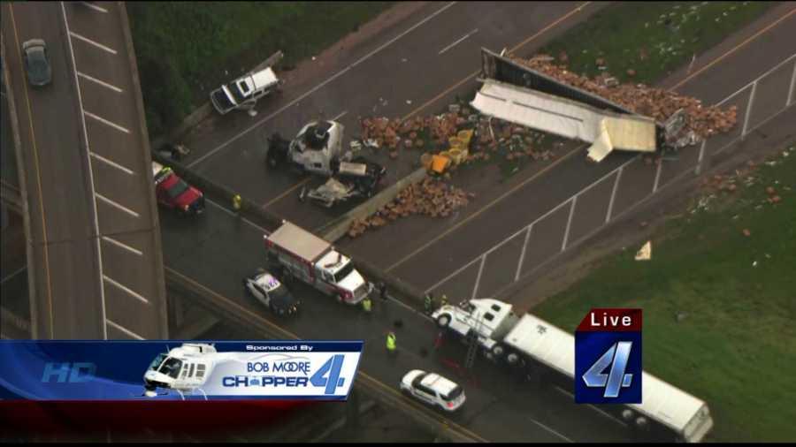 Tornado blows semis off overpass in Shawnee