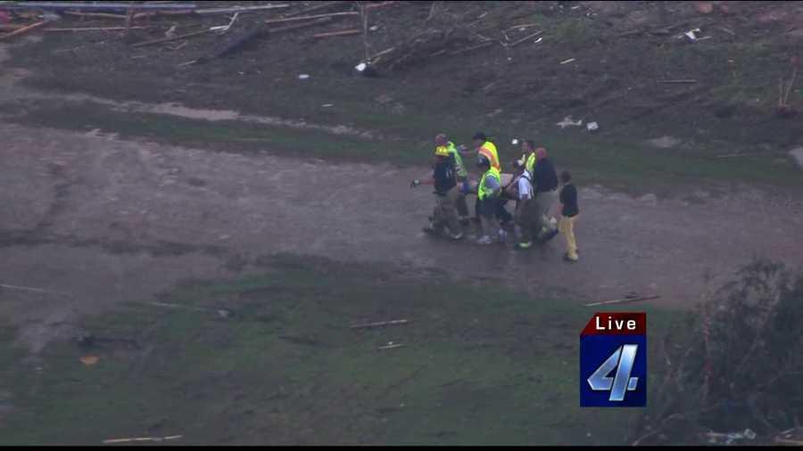 Emergency crews carrying Twin Lakes tornado victim