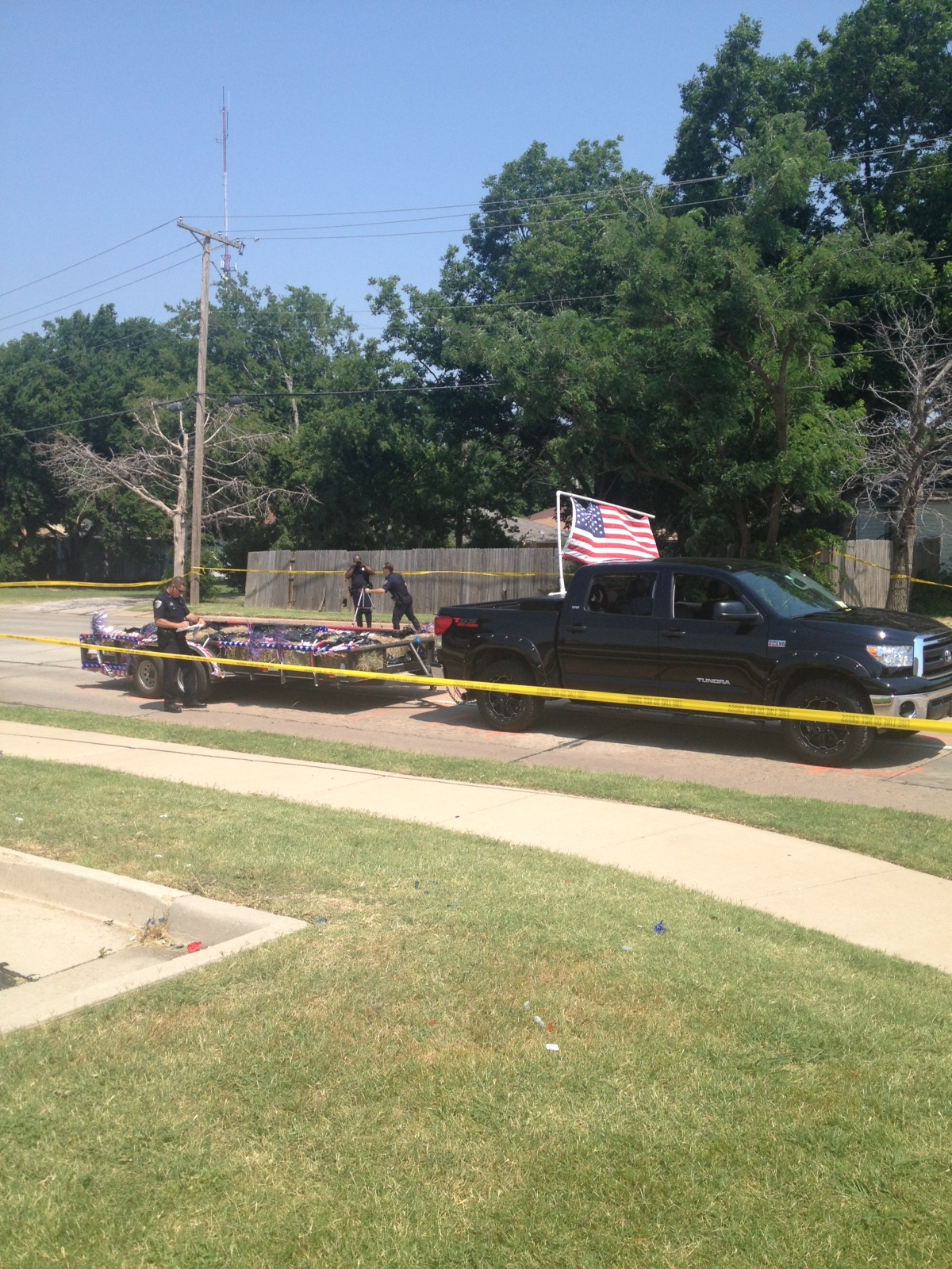 Trailer father was driving when boy fell off in parade.