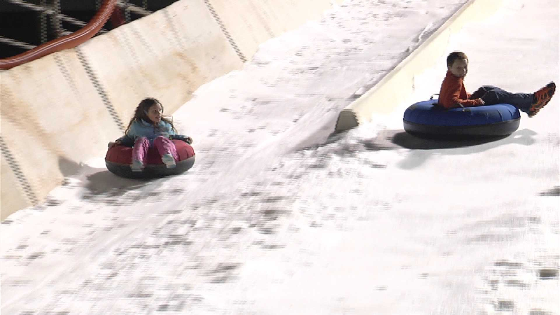 picture of people tubing in snow at bricktown ballpark
