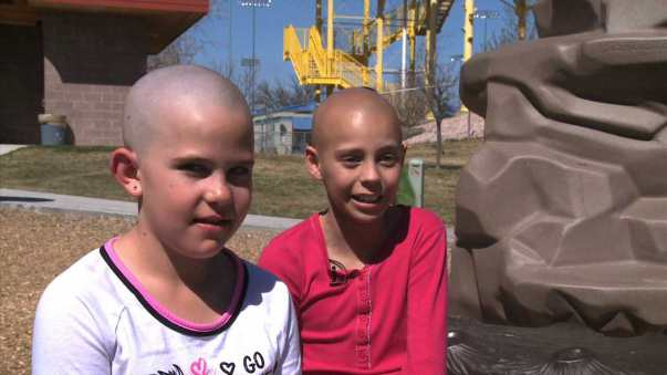 Photo: KDVR Kamryn, left, shaved her head to support her friend, Delaney, who is undergoing chemotherapy to treat cancer