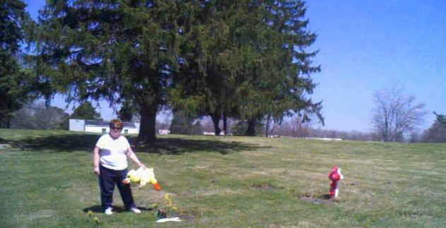 (Video captured a woman removing a stuffed animal from a baby's grave at Mansfield Memorial Cemetery on April 19, 2014/Courtesy: Ontario Police Department)