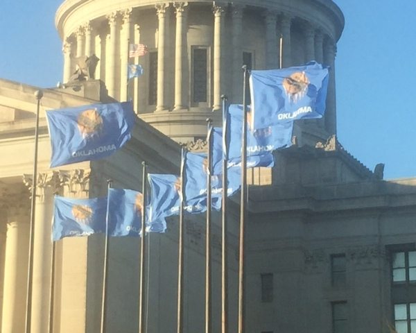 OKC flags blowing in the wind at capitol