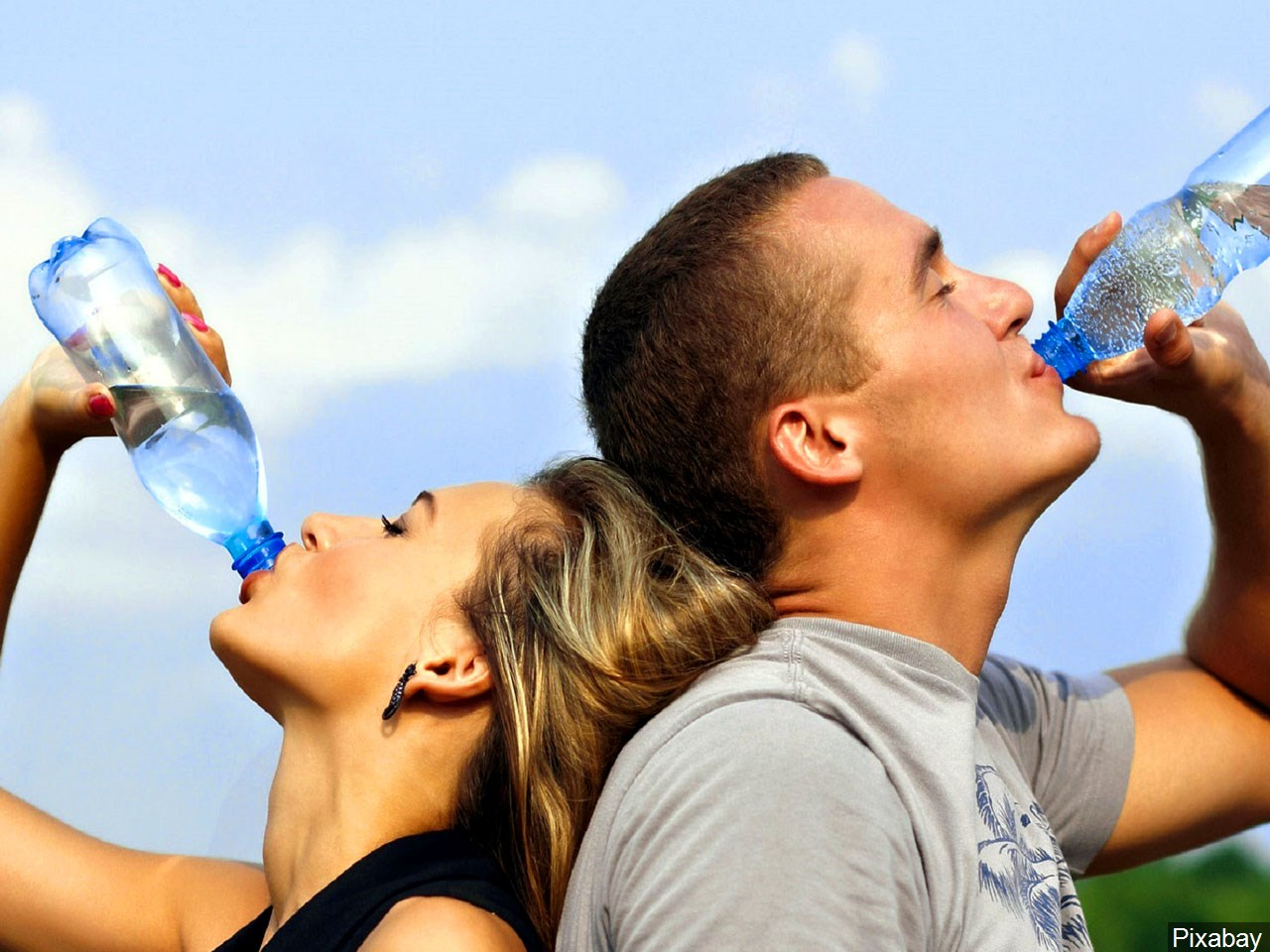 Two people drinking water