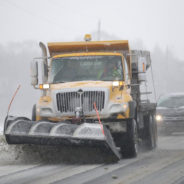 A plow clears snow from in Douglas County, Kansas, Sunday.