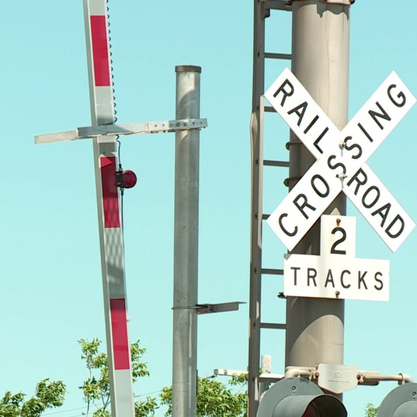 Railroad crossing bar