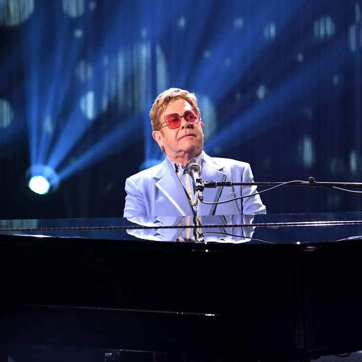 "BURBANK, CALIFORNIA - OCTOBER 16: (EDITORS NOTE: Retransmission with alternate crop.) Elton John performs live on stage at iHeartRadio ICONS with Elton John: Celebrating The Launch Of Elton John's Autobiography, ""Me"" at the iHeartRadio Theater Los Angeles on October 16, 2019. (Photo by Kevin Winter/Getty Images for iHeartMedia)"