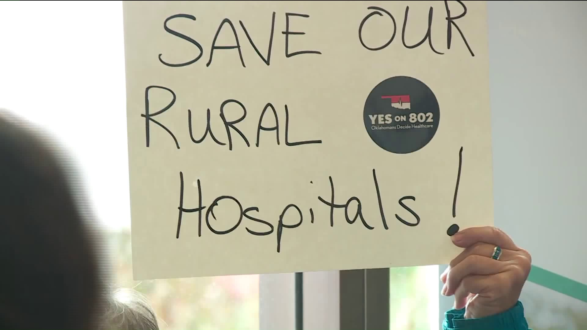 Volunteers turn in signatures for Yes on 802