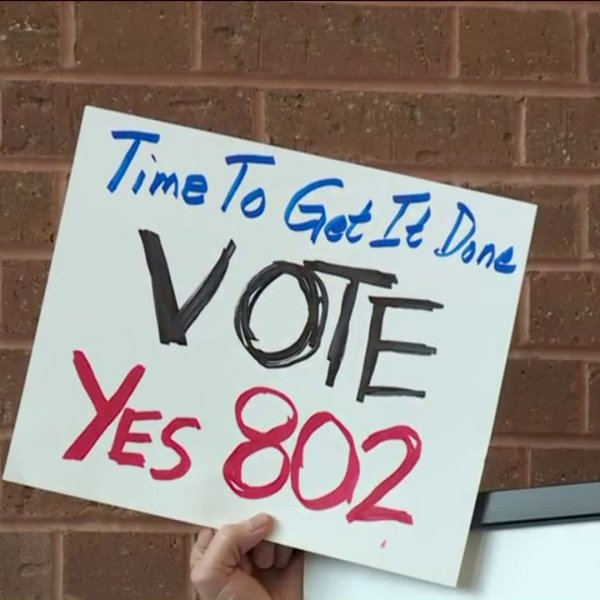 Volunteers turn in signatures for Yes on 80