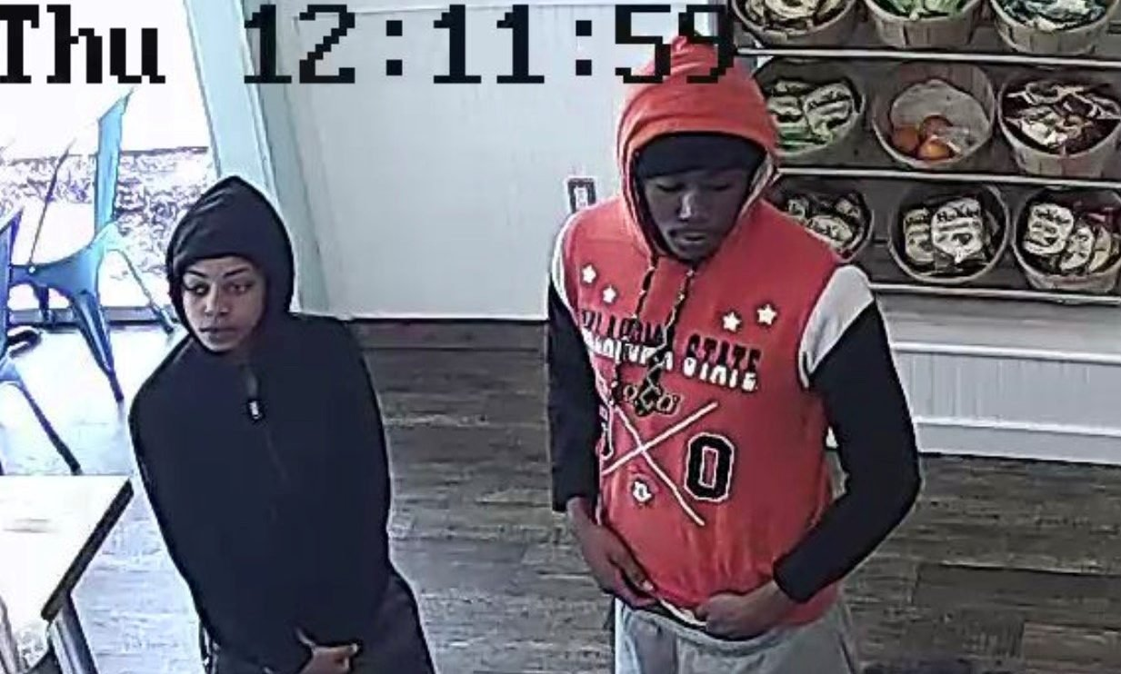 Surveillance photo of suspects for armed robbery story
