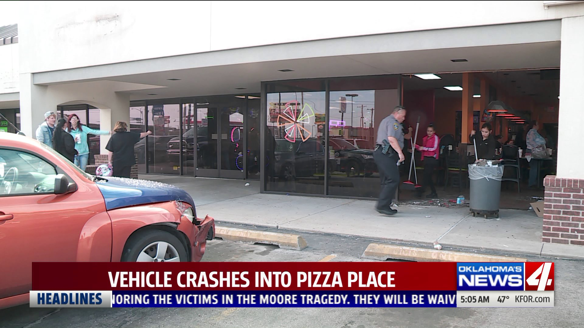 Car into pizza restaurant
