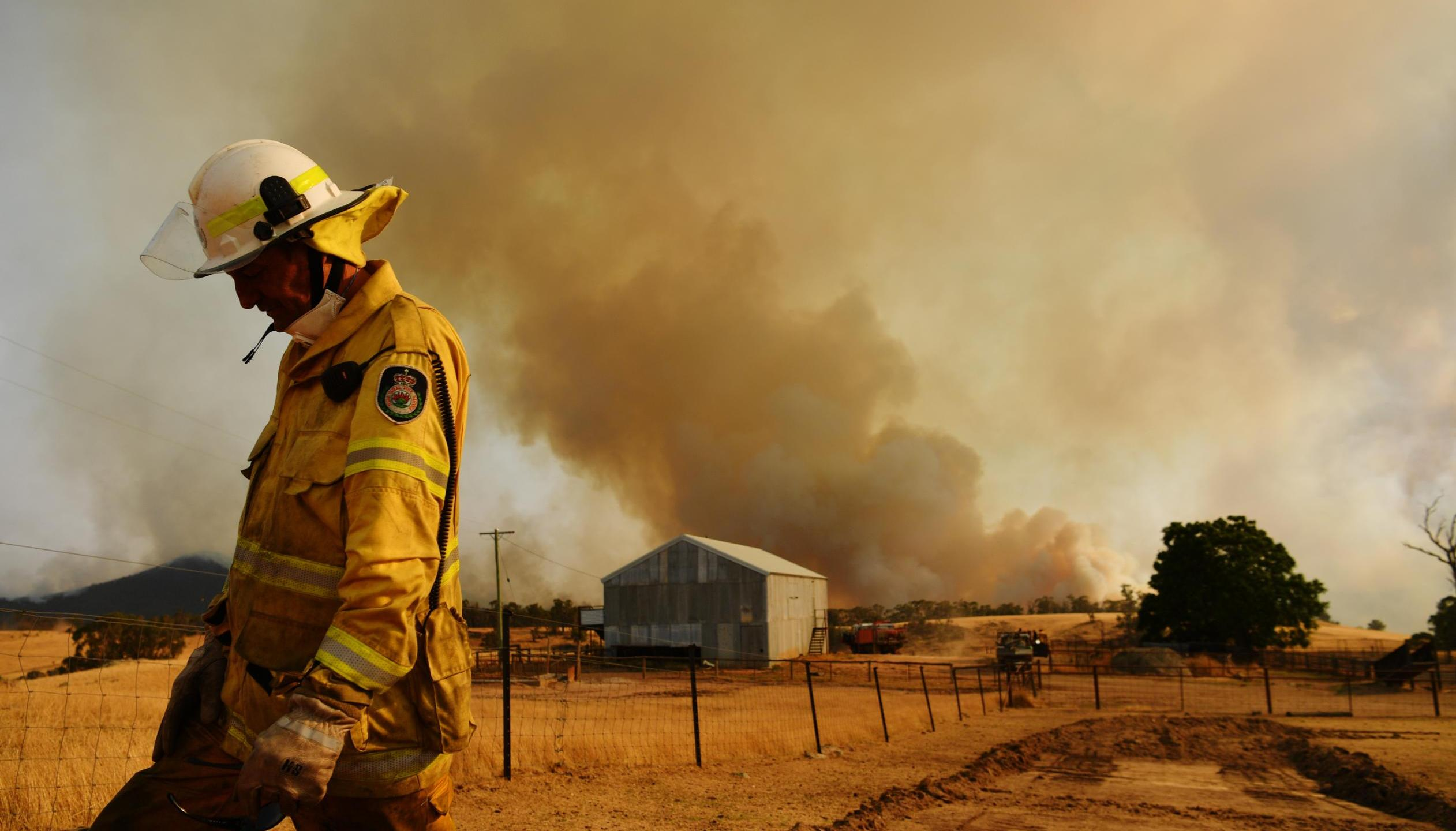 A Rural Fire Service firefighter Trevor Stewart views a flank of a fire on January 11 in Tumburumba, New South Wales.