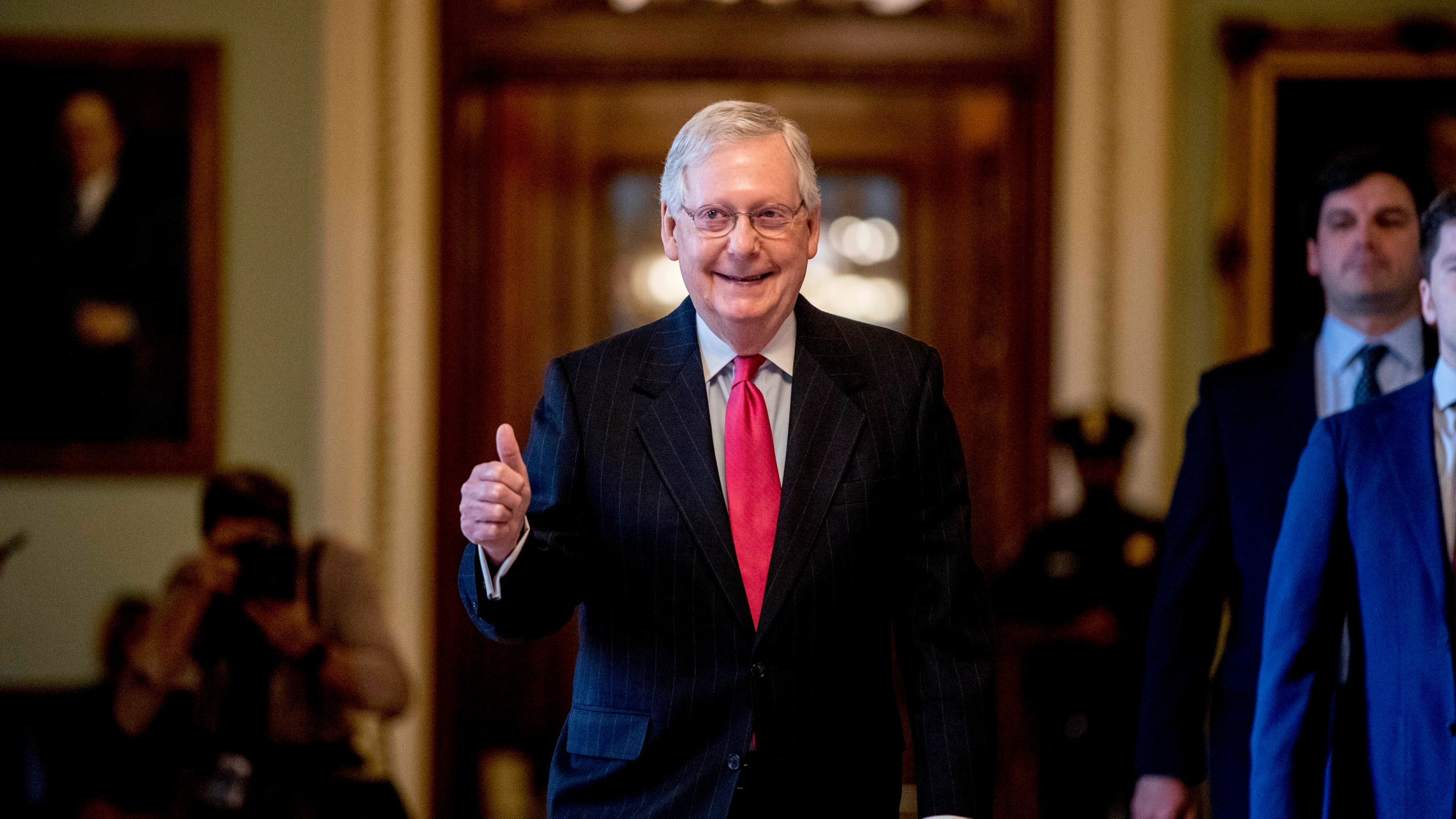 McConnell gives thumbs up and smile