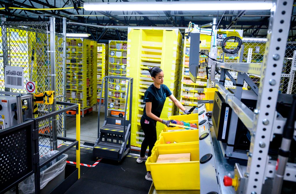 A woman works at a distribution station at the 855,000-square-foot Amazon fulfillment center in Staten Island