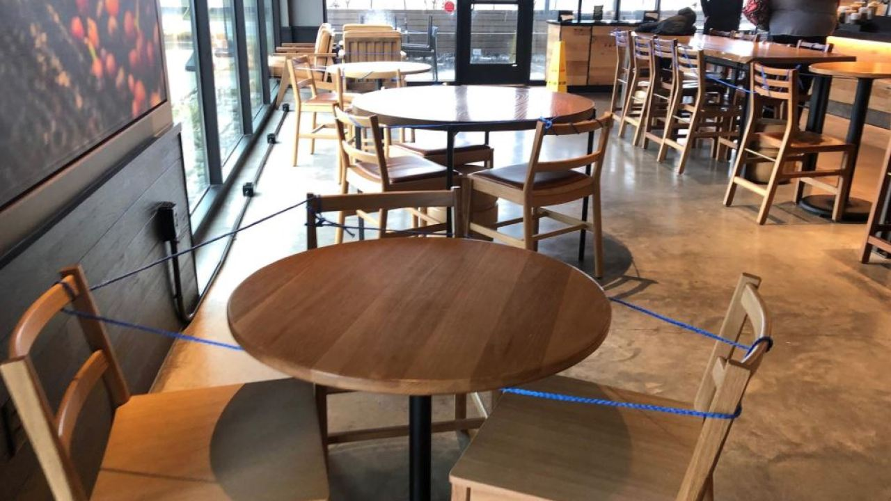 Chairs tied around tables at metro Starbucks in effort to ...
