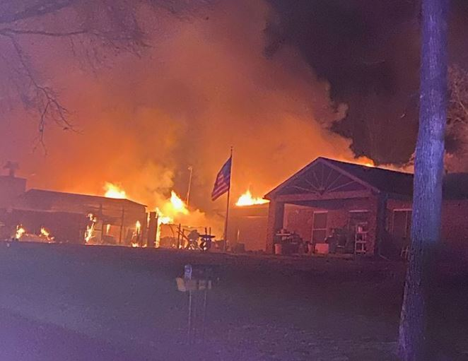 An elderly woman and her four dogs were saved in a house fire in February.