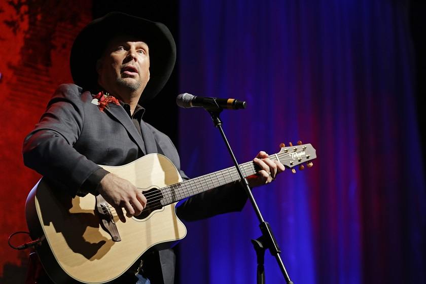 "FILE - In this Sunday, Oct. 7, 2012 file photo, Garth Brooks performs during the Nashville Songwriters Hall of Fame inductions in Nashville, Tenn. Like an ill-fated romance in a country song, Garth Brooks and Dublin just weren't meant to be. Promoters say five Irish concerts by the country music star have been canceled after a battle between venue owners and local residents. More than 400,000 tickets had been sold for the gigs, due to start at Croke Park stadium on July 25. The stint had been billed as a ""Comeback Special"" for the 52-year-old superstar after more than a decade of semi-retirement. Brooks was originally scheduled to play two shows, and when the number was increased to cope with demand, some residents complained. City authorities gave permission for three concerts, but promoter Peter Aiken said Tuesday that attempts to reach agreement on the final two had failed and ""no concerts will take place."" (AP Photo/Mark Humphrey, file)"