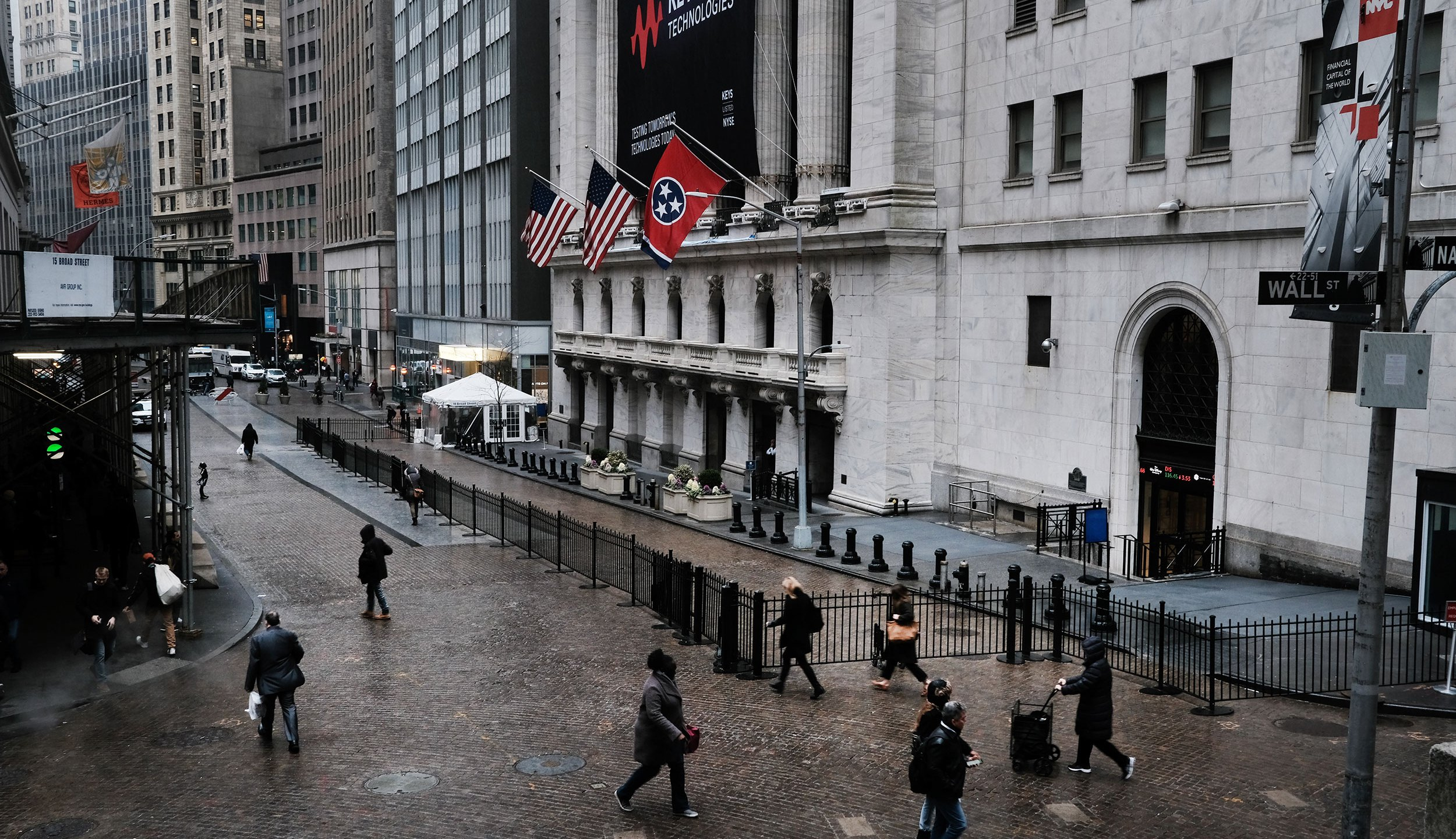 NEW YORK, NEW YORK - MARCH 03: People walk by the New York Stock Exchange (NYSE) on March 03, 2020 in New York City. Following a strong market surge yesterday, stocks one again fell on Wall Street as global concerns over the financial impact from the Coronavirus drive investments down. (Photo by Spencer Platt/Getty Images)