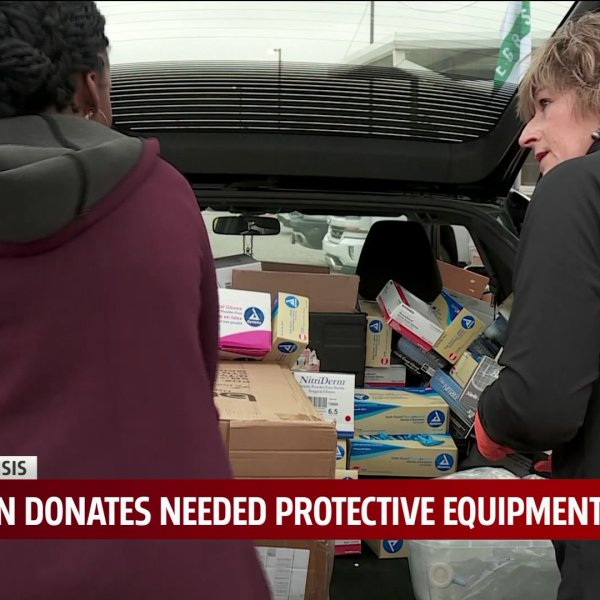 two women pack a car full of medical supplies
