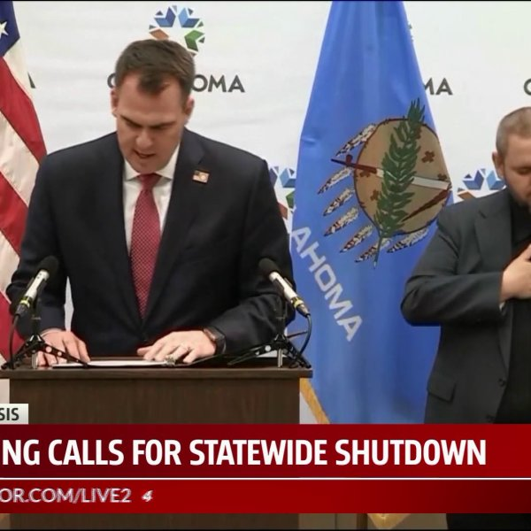 Governor stitt and ASL interpreter give covid-19 update on march 24