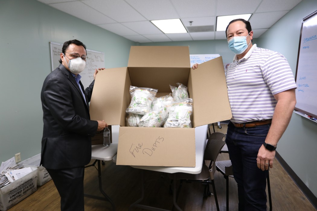 Cherokee Nation Principal Chief Chuck Hoskin Jr. and Deputy Principal Chief Bryan Warner prepare KN95 personal protection masks to be distributed to first responders and emergency personnel during the COVID-19 pandemic.