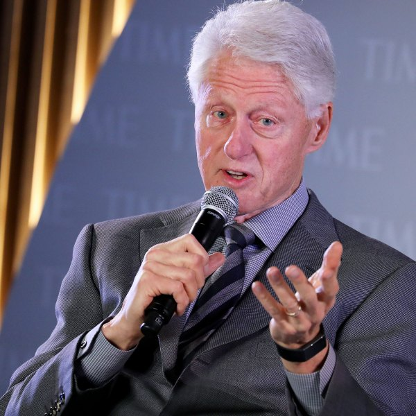 President Bill Clinton talks into mic