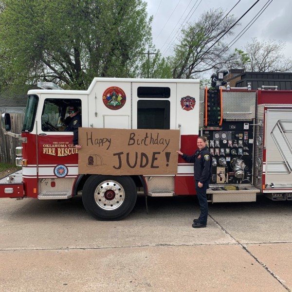 Firefighters hold up sign for Jude's birthday