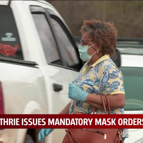 woman in parking lot wearing face mask