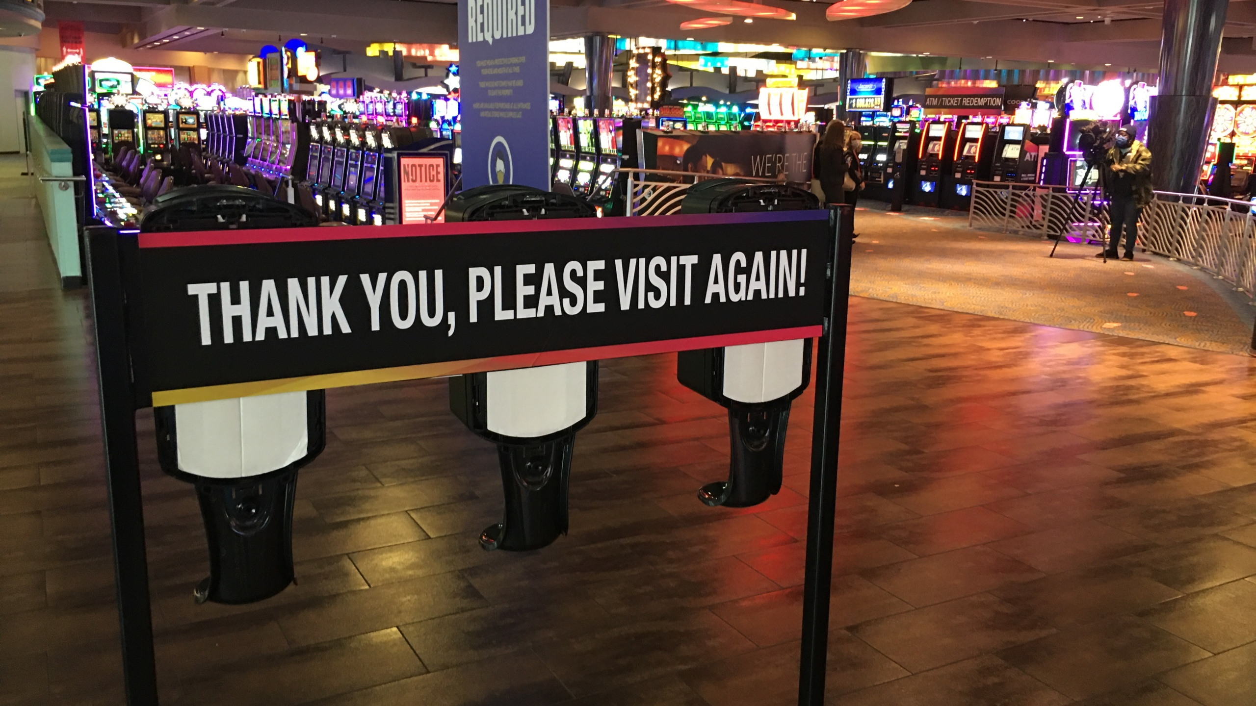 Sign at casino that reads 'thank you, please visit again'