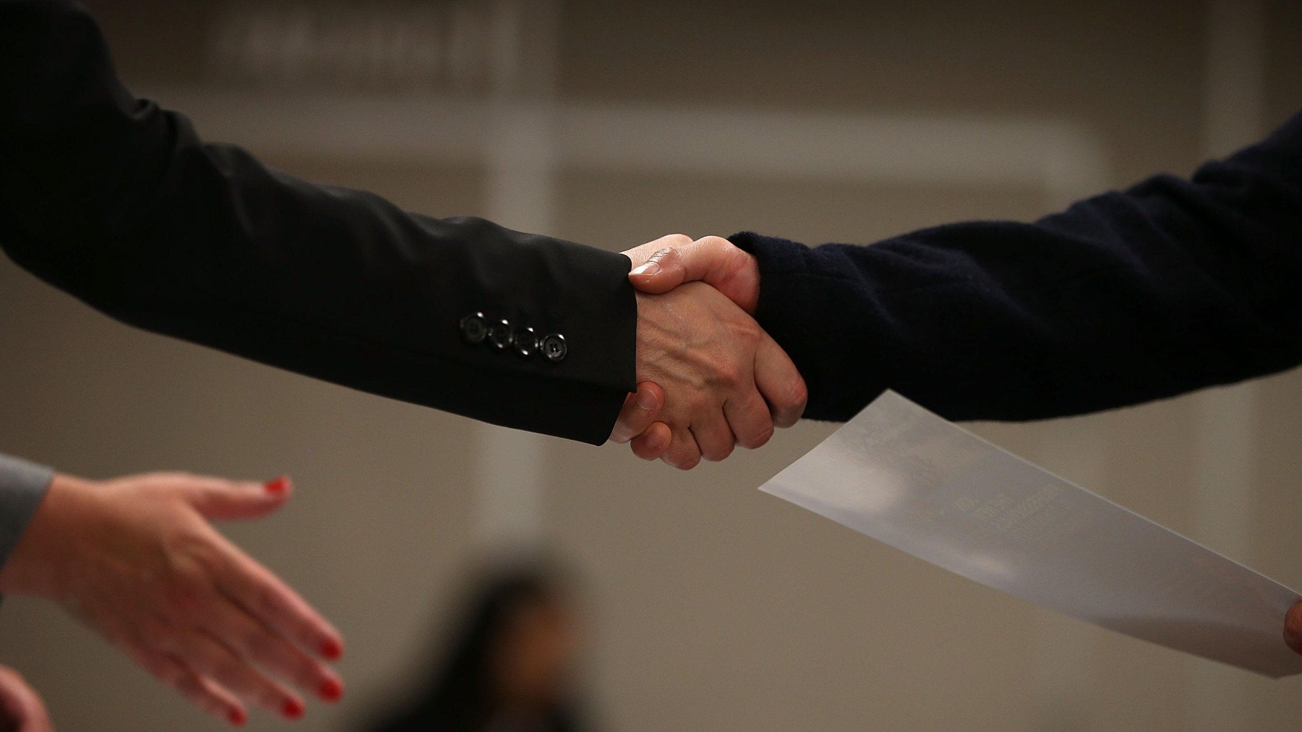 SAN FRANCISCO, CA - JUNE 04: A job seeker shakes hands with a recruiter during a HireLive career fair on June 4, 2015 in San Francisco, California. According to a report by payroll processor ADP, 201,000 jobs were added by businesses in May. (Photo by Justin Sullivan/Getty Images)