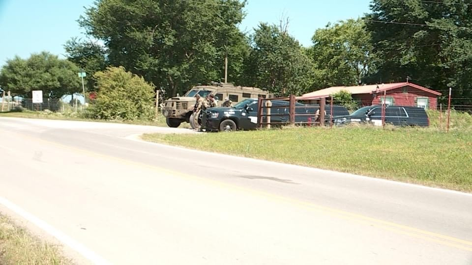 picture of police presence outside home in McLoud