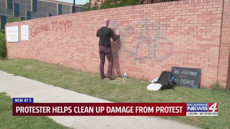 Oklahoma protesters clean graffiti left behind on walls