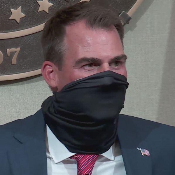 Gov. Stitt wearing a mask