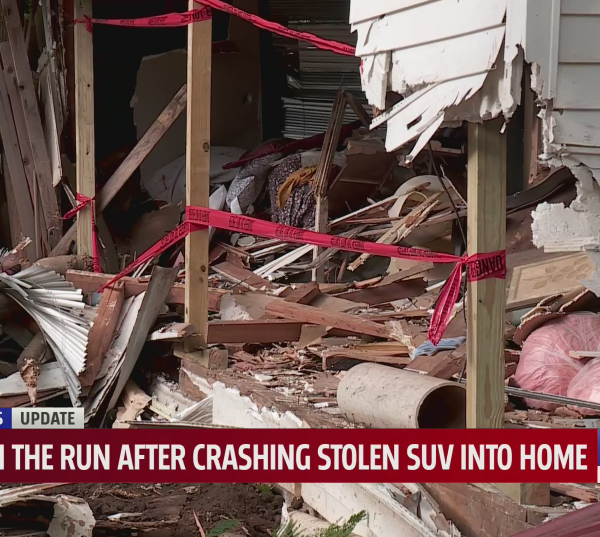 A suspect is on the run after crashing a stolen SUV into a metro home.