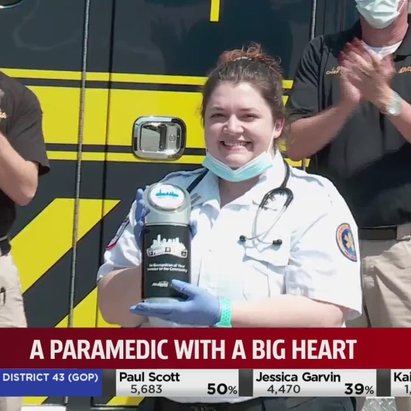 Picture of paramedic being honored