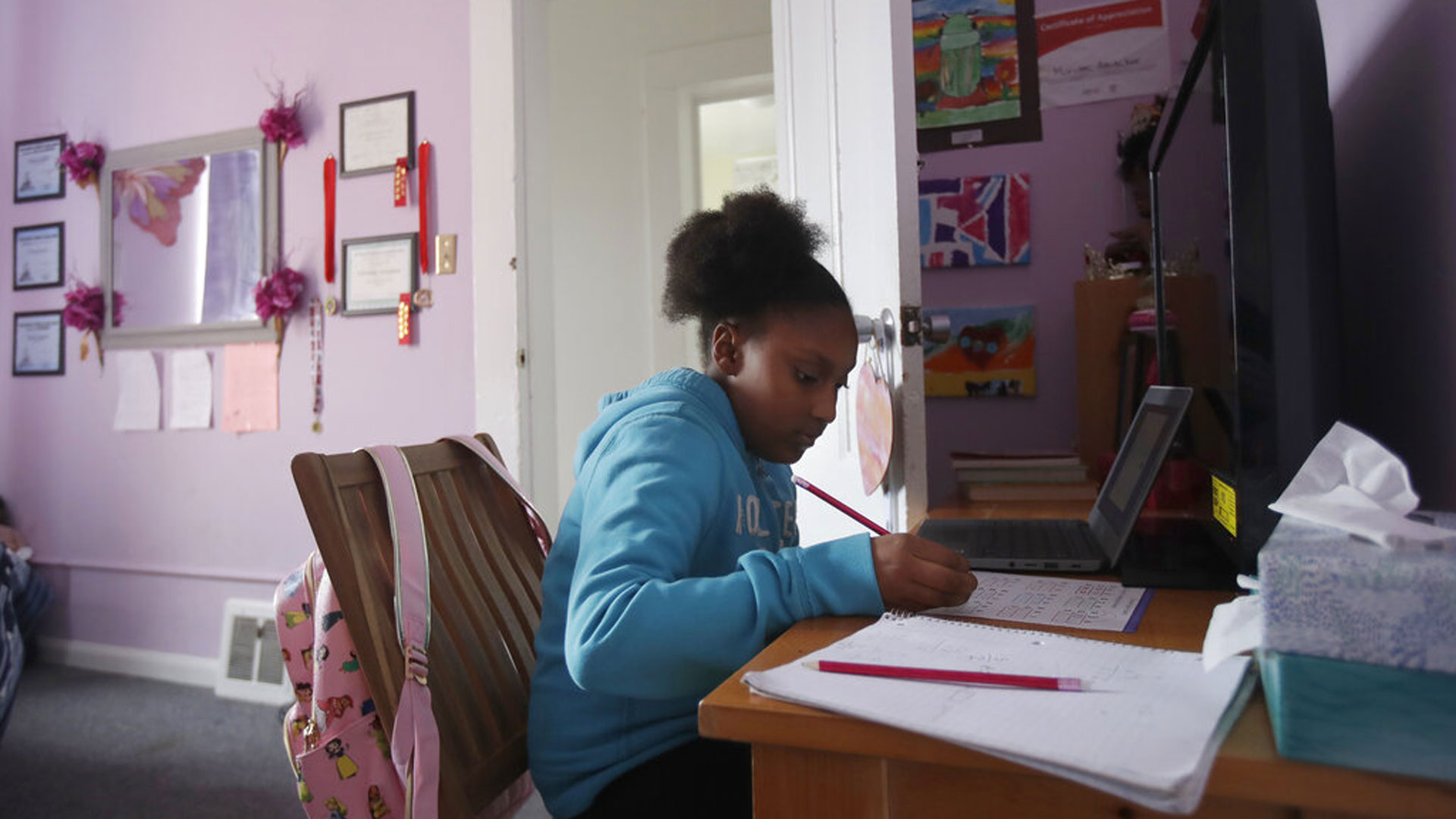 In this April 9, 2020, file photo, Sunnyside Elementary School fourth-grader Miriam Amacker does school work in her room at her family's home in San Francisco. (AP Photo/Jeff Chiu, File)