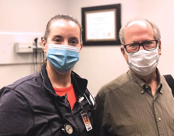 INTEGRIS pulmonologist, Sarah Matousek, M.D. and Father Mark Mason