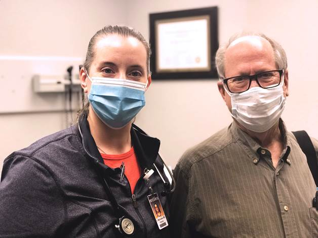 INTEGRIS pulmonologist, Sarah Matousek, M.D. and Father Mark Mason