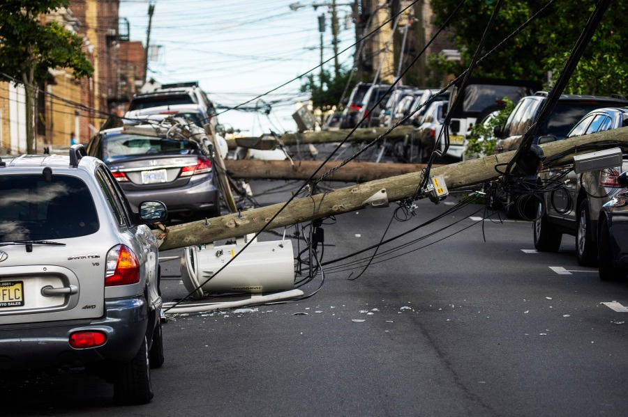 UTTENBERG, NJ - AUGUST 04: A power line drops at the street after Tropical Storm Isaias and its treacherous winds and heavy rain passed through on August 4, 2020 in Guttenberg, New Jersey. Fallen trees and debris littered the streets across the area, leaving thousands of people without power and disrupting subway service, The storm, which regained hurricane strength Monday night, brought heavy rainfall, lightning, strong winds and flooding to the New York City area on Tuesday afternoon. (Photo by Eduardo Munoz Alvarez/Getty Images)