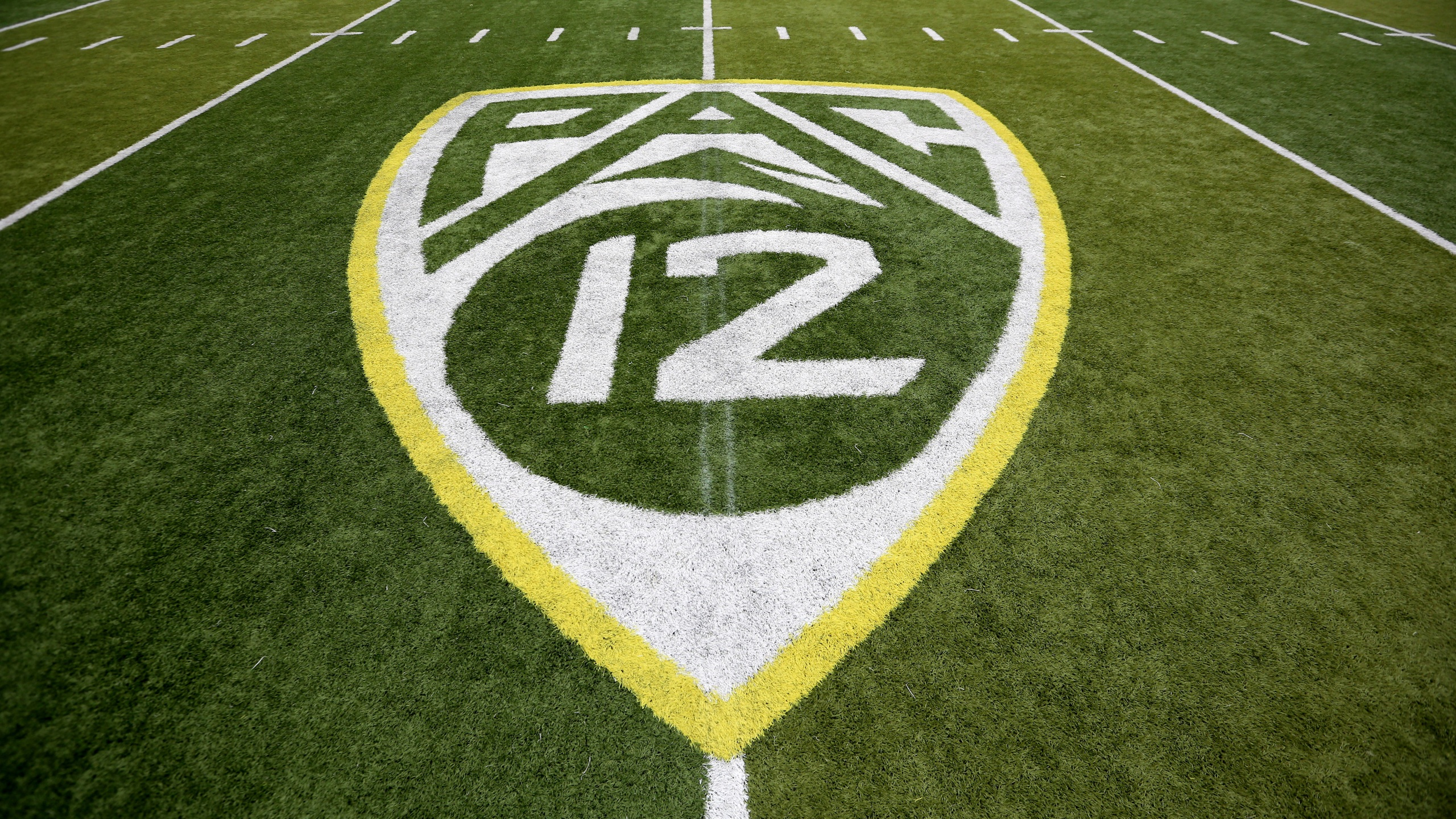 FILE- In this Oct. 10, 2015, file photo, a PAC-12 logo is displayed on the field before an NCAA college football game between Washington State and Oregon in Eugene, Ore. The Pac-12 university presidents and chancellors will meet Friday, Sept. 17, 2020, and be presented options for staging a fall football season, but Commissioner Larry Scott says a vote by the the CEO Group is not expected. (AP Photo/Ryan Kang, File)