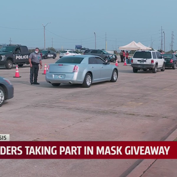 City leaders give away masks