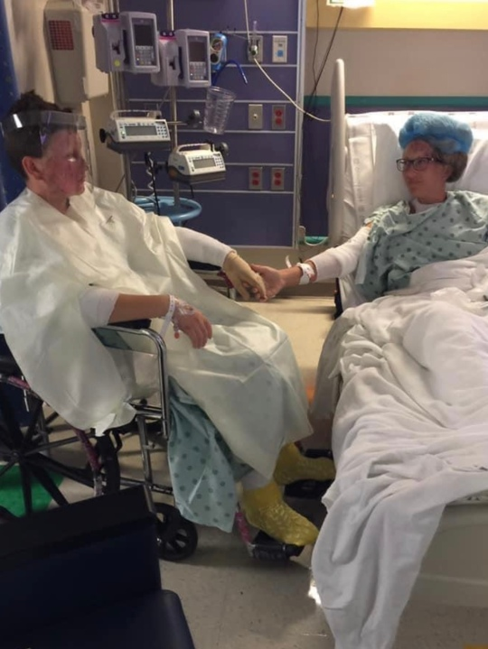 Tanda and Hayden Maguire sit in hospital room together