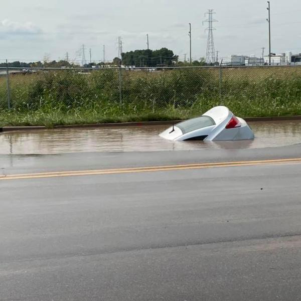 Car submerged in sinkhole