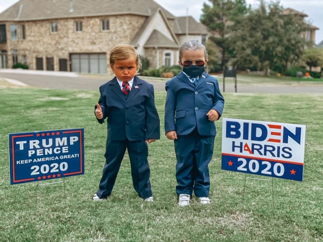 picture of twin girls in a Trump and Biden Halloween costumes