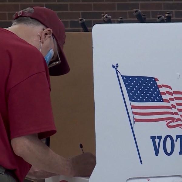 poll voter mask photo