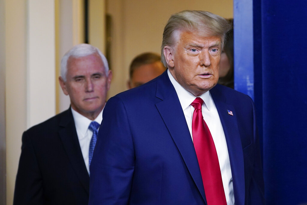 President Donald Trump walking out to speak in the Brady Briefing Room in the White House, Tuesday, Nov. 24, 2020, in Washington. Walking behind Trump is Vice President Mike Pence. (AP Photo/Susan Walsh)