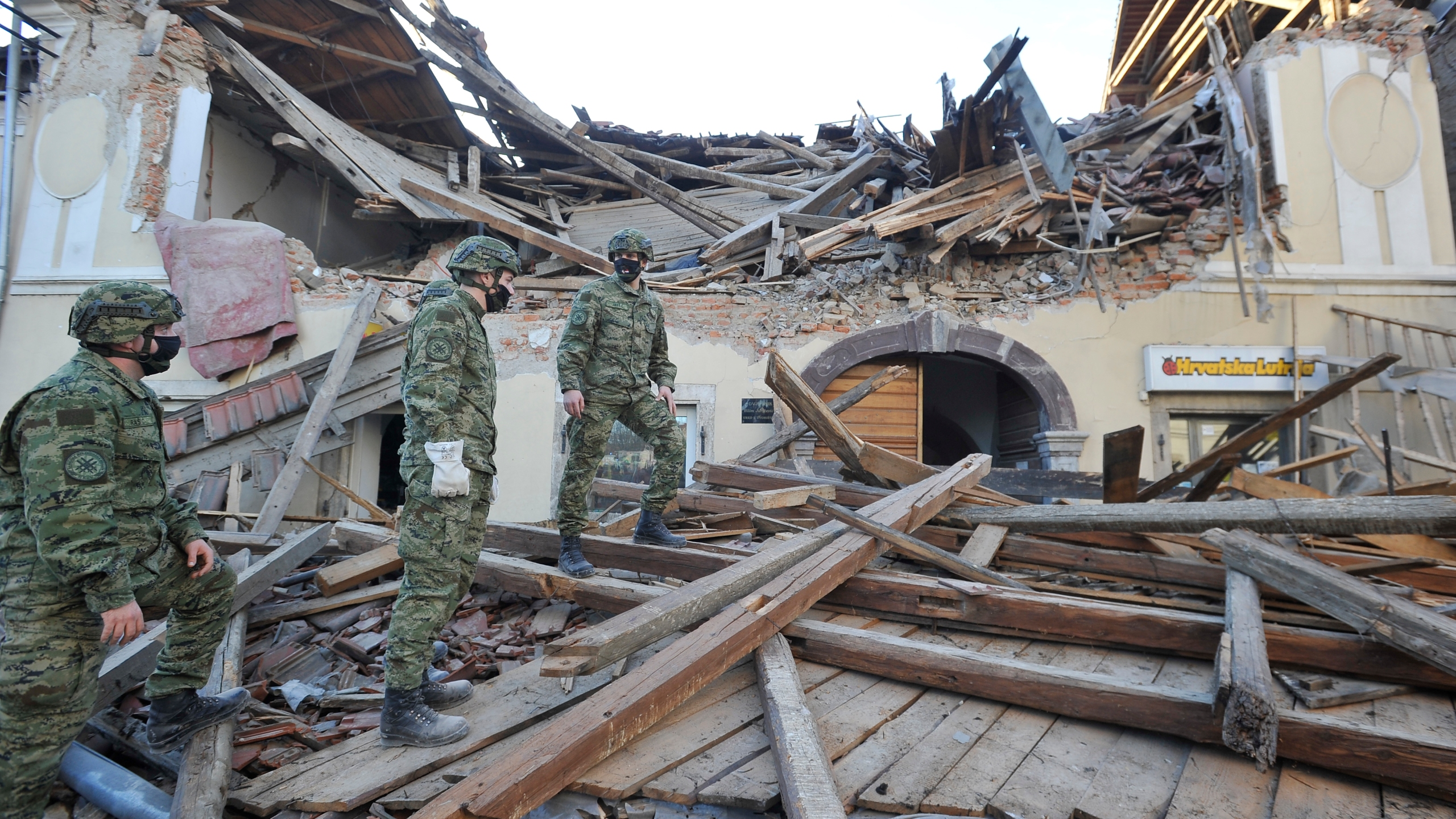 Soldiers inspect the remains of a building damaged in an earthquake, in Petrinja, Croatia, Tuesday, Dec. 29, 2020. A strong earthquake has hit central Croatia and caused major damage and at least one death in a town southeast of the capital. (AP Photo)