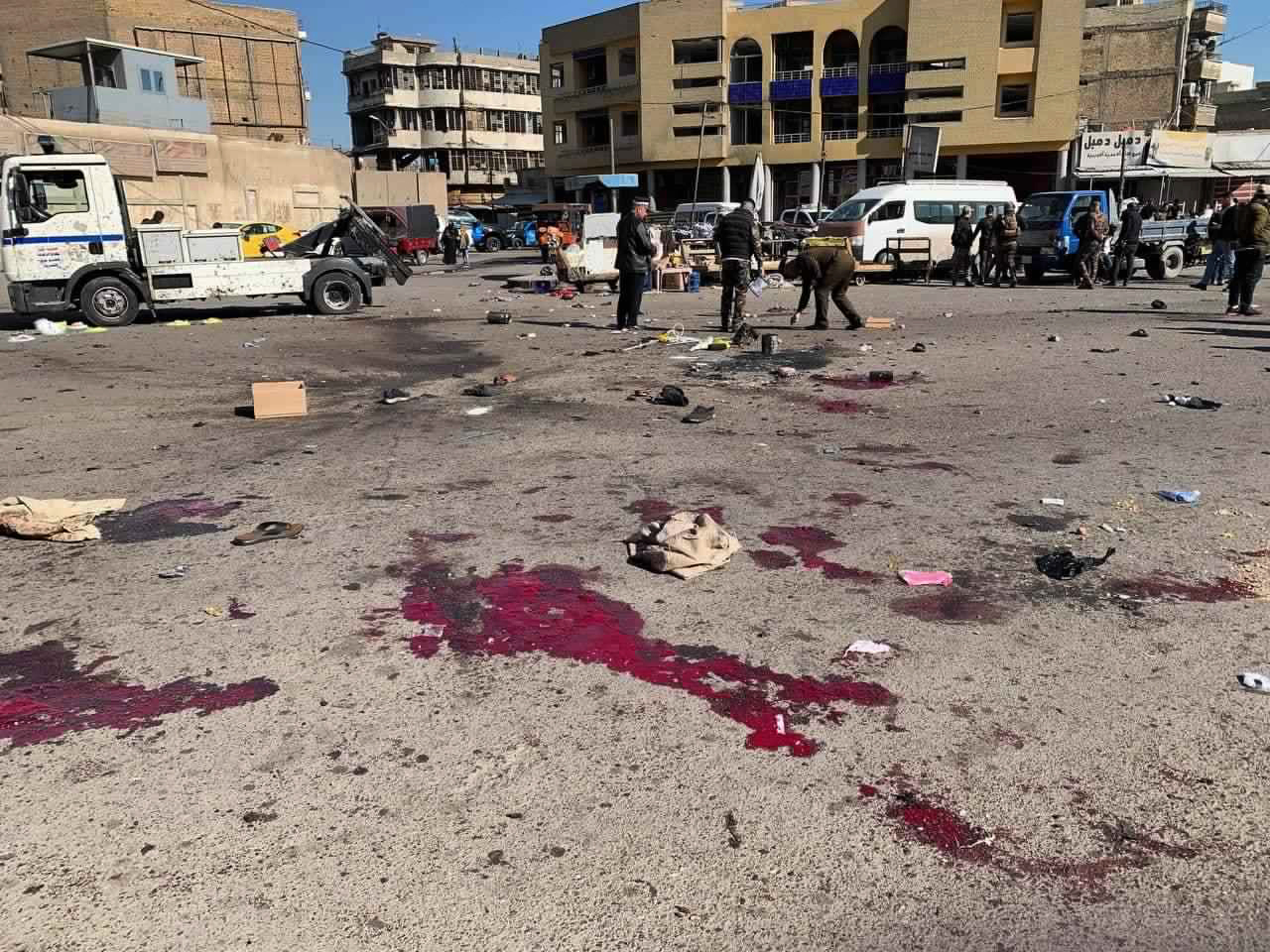 Security forces work at the site of a deadly bomb attack in a market selling used clothes, Iraq, Thursday, Jan. 21, 2021. Twin suicide bombings hit Iraq's capital Thursday killing and wounding civilians, police and state TV said.
