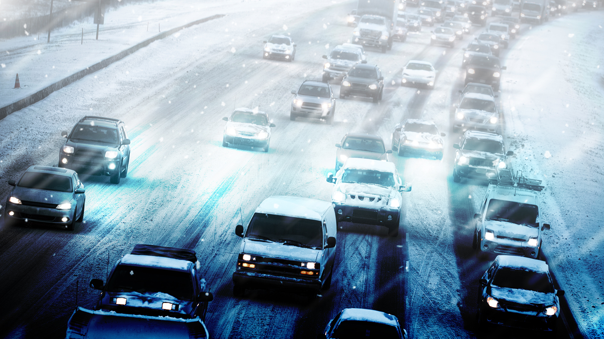 generic image of cars on highway in snow
